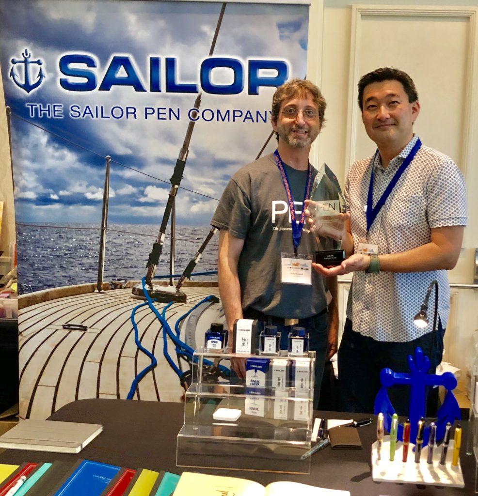 Pen World : Nicky Pessaroff presents Sailor distributor Don Takemura with Sailor's 2019 RCA awards.